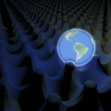 Unusual depiction of glowing planet earth in an egg carton box, south america in view Royalty Free Stock Photography
