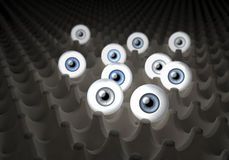 Unusual depiction of a group of eyes lying in an egg carton, illuminating surrounding Royalty Free Stock Image