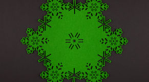 Unusual design christmas background with green snowflakes and copy space Stock Photo