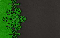 Unusual design christmas background with green snowflakes and copy space Royalty Free Stock Photo