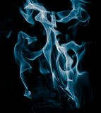 Unusual drawings of smoke on a black background. Unusual drawings of smoke . It`s very beautiful and not ordinary stock image