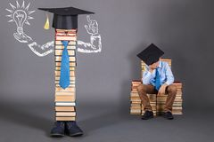 Unusual education concept with a dozing boy to whom a brilliant. Idea came royalty free stock photos