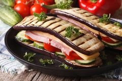 Unusual eggplant sandwich with vegetables, ham and cheese Royalty Free Stock Photography