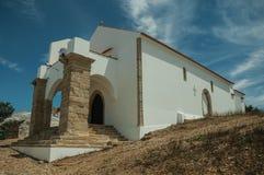 Unusual entrance church on street of Evoramonte stock image
