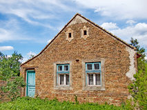 Unusual facade of an old farmhouse Royalty Free Stock Image