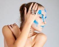 Unusual facial make-up model Royalty Free Stock Photos
