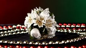 Unusual flower toy for Christmas or New Year and. Unusual shiny flower toy for Christmas tree for decoration Christmas or New Year and red and white beads stock video