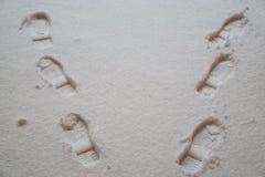Footprints on a snow Stock Photo