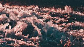 Unusual forms of rose quartz color ice and water. Splashing. Close up video stock video footage
