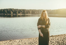 Unusual Gothic girl with long red hair reflects at lake Royalty Free Stock Image