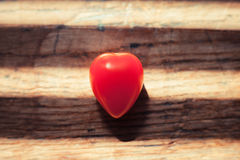 Unusual heartshaped tomato on wood table Stock Photo