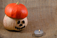 Unusual helloween orange hat pumpkin  andcandle fire Stock Photos