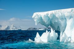 Jaws of Ice - Iceberg surrounded by turqouise sea, Antarctica stock image