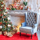 The unusual interior of the living room in the loft is decorated. With a Christmas tree. Concept of Happy Christmas, New Year, holiday, background stock photography
