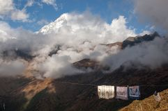 Unusual juxtaposition - drying laundry and Himalayan peaks with royalty free stock photography