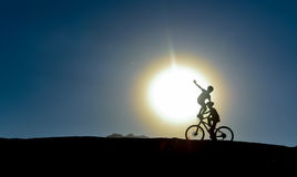 Unusual kids on bikes. Adventurous cyclist;unusual kids on bikes stock images