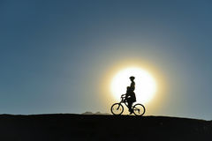 Unusual kids on bikes. Cycling fun ;unusual kids on bikes stock photos