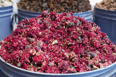 Unusual, local beauty and care ingredients at the traditional markets in Marrakesh, Morocco. Horizontal shot of a stack of red, dried rose buds and petals, at stock images