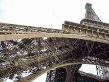 Unusual look on Eiffel Tower. Uncommon and original perspective on Eiffel Tower in Paris in France. White background enabling separation Stock Image
