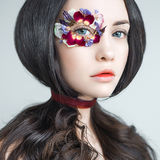 Unusual makeup with flowers Stock Photo