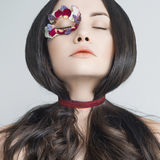 Unusual makeup with flowers Stock Image