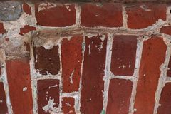 Unusual masonry of red bricks, ancient stone texture stock image