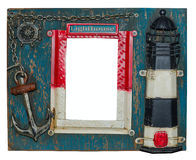 Unusual nautical photo frame. Lighthouse, anchor, chain, steering wheel royalty free stock image