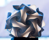 Unusual paper folded lampshade Stock Image