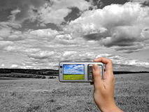 Unusual photo. Black and white landscape coloured on smartphone dispay Royalty Free Stock Images