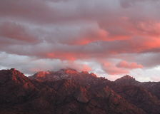 Unusual pink and purple sunset clouds over the Pusch Ridge  mountains in Tucson, Arizona Royalty Free Stock Photography