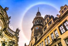 Unusual rainbow around the spire of a beautiful ancient building. Beauty Unusual rainbow around the spire jf the chгrch stock photography