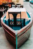 Unusual restaurant interior: dining table in the colorful fish boat. Marine ambience.  Stock Images