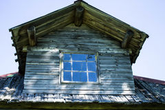 The unusual roof of the rural wooden house Stock Image