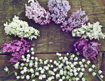 Unusual round frame of lilac and lily of the valley. Stock Photos