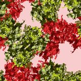 An unusual seamless pattern in the form of green and red figures on a pink background. It is a colorful seamless pattern with imitation of red flowers that can Stock Image