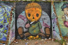 Unusual self carving pumpkin graffiti Stock Image