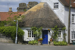 Round shaped thatched roof house Stock Photo