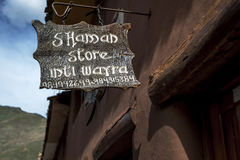 An unusual sign advertising a shaman store in Pisac, Peru. Royalty Free Stock Photography