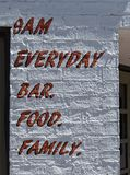 Unusual sign, bar and food stock images