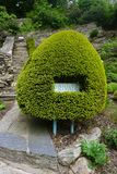 Unusual sign surround. Novel Hedge Sign Surround pictured in Portmeirion in North Wales United Kingdom Royalty Free Stock Photography