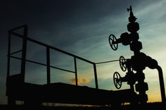 Unusual silhouette of gas rig drill, on the background of blue a Stock Image