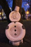 Unusual snowman. Stands on the streets of our city. Christmas decoration Royalty Free Stock Images