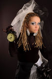 Unusual theatrical makeup. A girl with an unusual theatrical makeup in the dark tones Royalty Free Stock Image