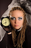 Unusual theatrical makeup. A girl with an unusual theatrical makeup in the dark tones Royalty Free Stock Photo