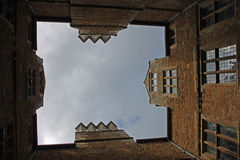 Unusual view of country house courtyard, cotswolds. With leaded lights and stonework Stock Photography