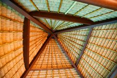 Unusual view of the roof woven from dry palm leaves. stock image