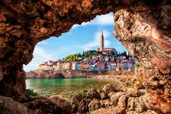 Free Unusual View With Old Clock Towe In Piran Through A Rock Hole. The Tourist Center Of Slovenia. Popular Tourist Attraction. Royalty Free Stock Photos - 148066828