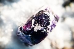 Unusual violet handmade soap, macro photo in winter on the snow, amethyst stone. Sunny photo stock images