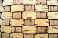 Wall made of woven birch bark stock images