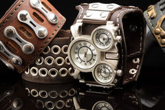 Unusual watches. several alternatives dials. Wide leather bracelet Royalty Free Stock Photos